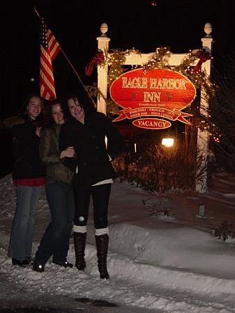 The Eagle Harbor Inn: the girls with Eagle Harbor Inn sign