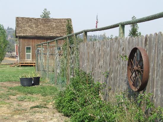 Long Hollow Guest Ranch: Looking down the side of the herb and flower garden towards the ranch store.