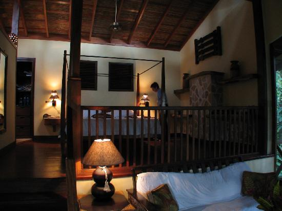 Ian Anderson's Caves Branch Jungle Lodge: Treehouse Suite.  View from sitting area into bedroom portion.