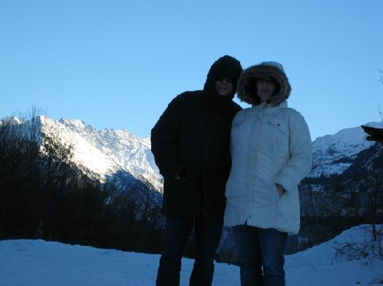 Hotel Falken - Luzern: My husband and me in front of a rather large Alp outside Iselwald, Switzerland.