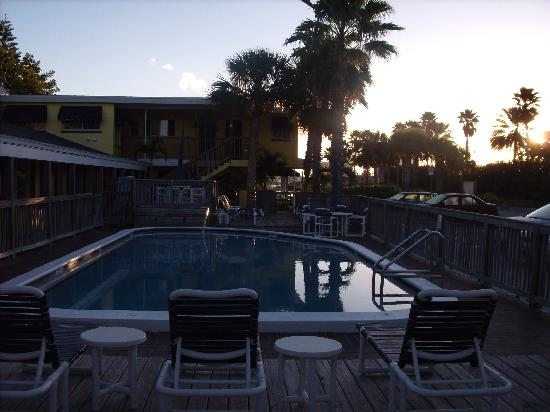 Barefoot Bay Resort and Marina: Barefoot Bay-pool area-sun is rising