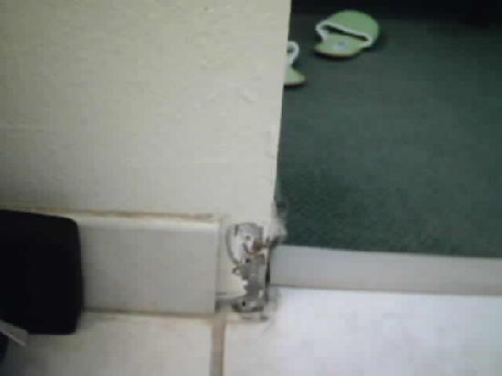 Extended Stay America - Fayetteville - Cross Creek Mall: chunk of carpeting and wall missing in bathroom
