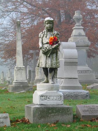 Crown Hill Cemetery: Statue of Mary Ella McGinnis, one of over 100 statues at Crown Hill