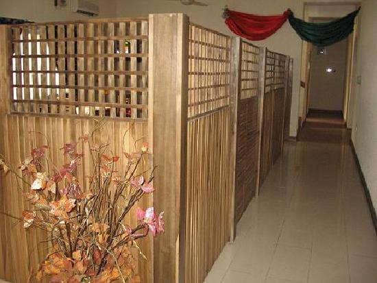Lekki Inn: The entrance hallway - the dining area is behind the screen