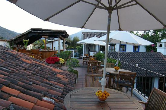 Casa Encantada: The rooftop terrace (the rooftop suite's 3 windows are on the right)