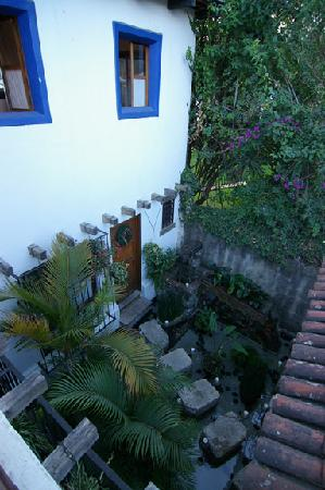 Casa Encantada: the walkway to the lily pond rooms