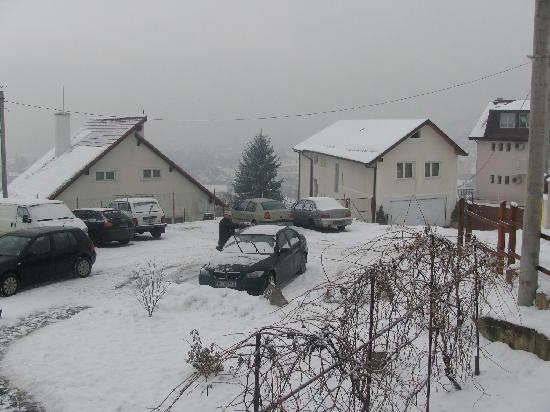 Pensiunea Riunione: after the snow came. parking lot outside the hotel. overlooking the Brasov below.