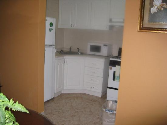 Hotel Coral Suites: Kitchen-it's behind mirror in prev pic