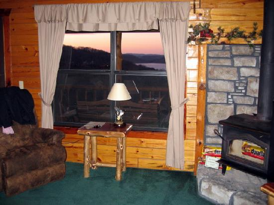 Lake Shore Cabins on Beaver Lake: window overlooking lake and fireplace cabin 6