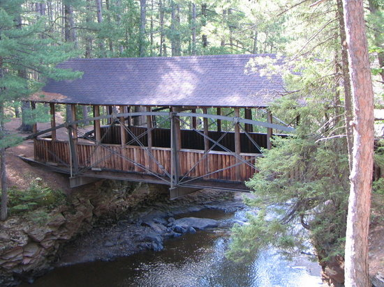 South Range, WI: Covered bridge over the falls.