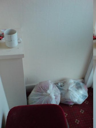 Fire Exit blocked by chair and assorted rubbish - The Lismore Hotel Banbury.