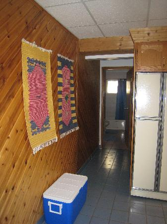 Belles Mountain Chalet: Hallway to one of the rooms, seen from the kitchen