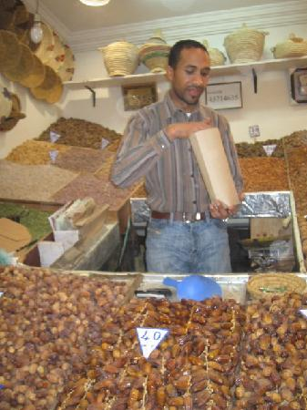 Riad Tizwa: Date and nut seller
