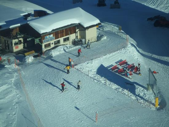 The Excelsior: View of skiers from the cable car