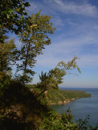 Pictured Rocks National Lakeshore: AuSable lighthouse is a tiny speck on the point