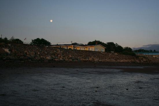 Moon over Beach Breeze Motel at low tide