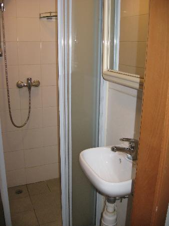 Showering Area, small good enuff for one to stand