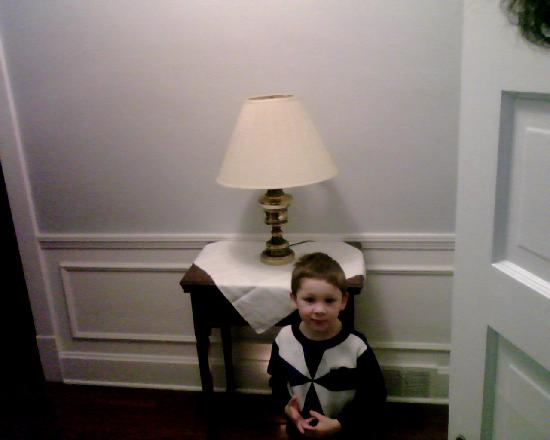 College House B&B: one of Kathys cute twin boys who followed me through the house taking my picture with his toy ca