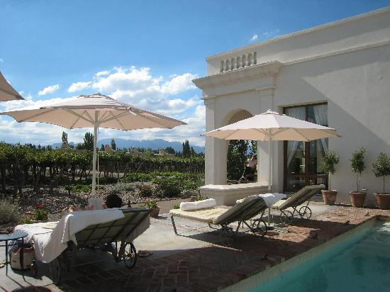 Cavas Wine Lodge: laying by hotel pool with view of vineyards
