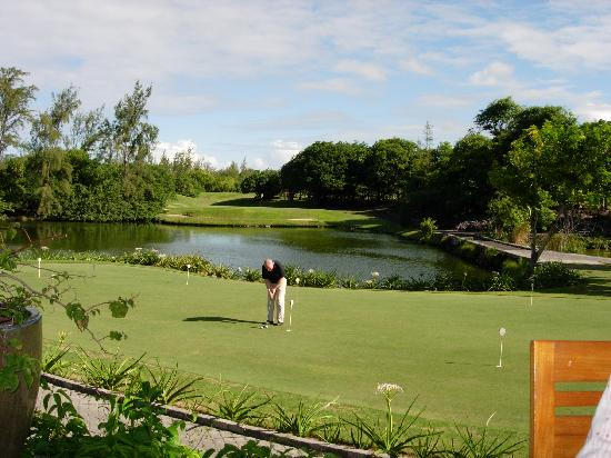 Constance Belle Mare Plage: Legends practice green and 9th green in background