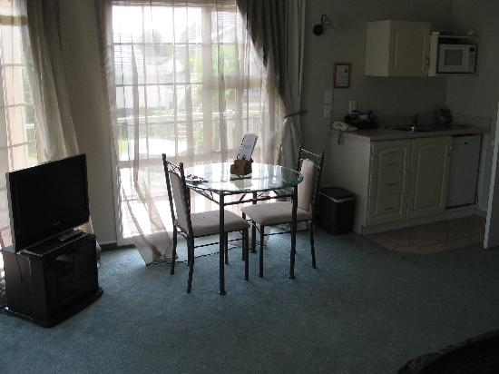 Silver Fern Rotorua - Accommodation and Spa: dining table and chairs and TV/DVD