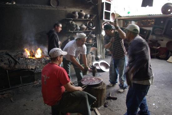 Santa Clara del Cobre: Workers forging copper. Several of the shop in town have workshops out back.
