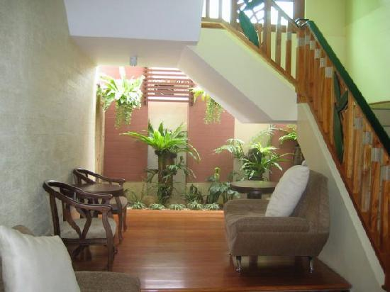 Boracay Beach Club: A lounge area by a hallway.