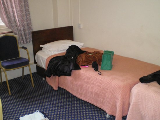 The County Hotel : a bed in the bedroom
