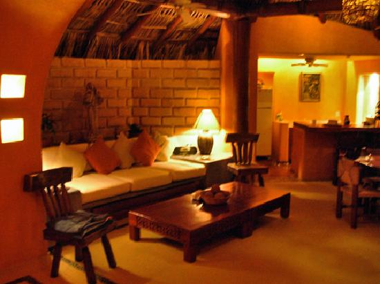 Villa Carolina Hotel: at night in the open air area of the master suite, sofa & kitchen