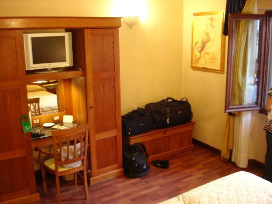 Closet, desk and TV area