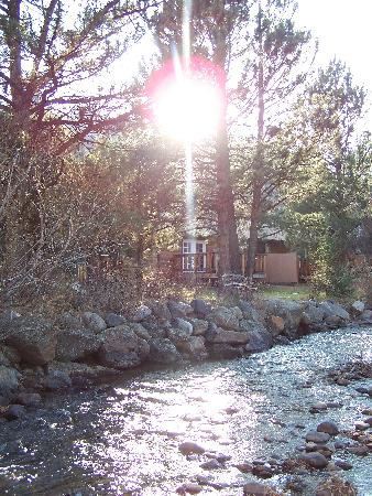 Deer Crest Resort: My attempt at a postcard shot...sun through trees behind the Fall River