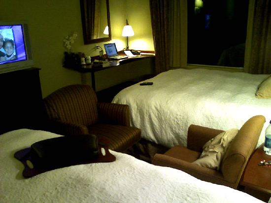 Hampton Inn & Suites Westford - Chelmsford: Room with two Queen beds - arranging chairs for TV, work desk