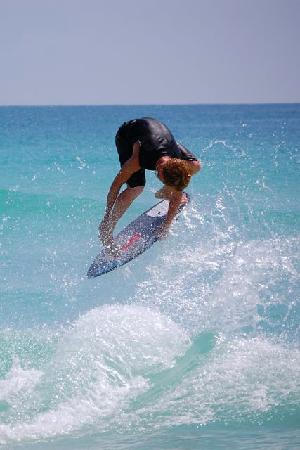 White Sands Beach Resort: skimboarder on beach