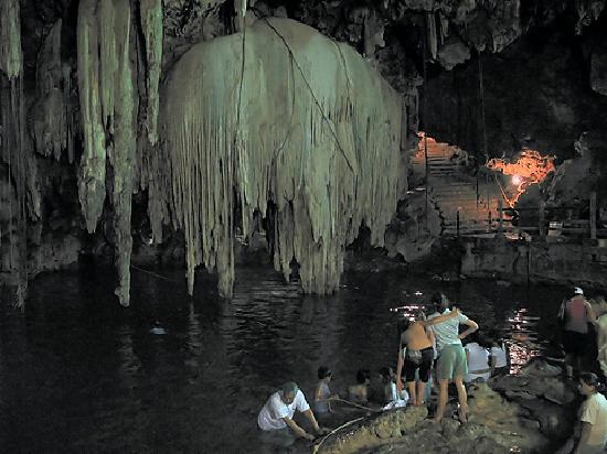 D'zitnupt Cenote - We watched someone jump off the huge stalegmite