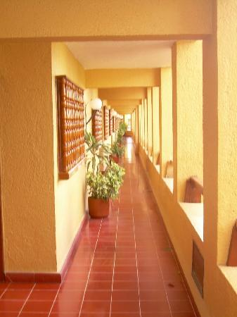 Hallway to rooms on first floor at Suites Colonial