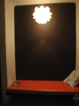Teetotum Hotel: Built-in seating with cool light fixture.