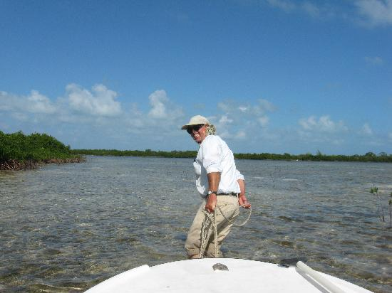 Bimini: Capt. Tommy pulling us through the mangrove after leaving the healing hole
