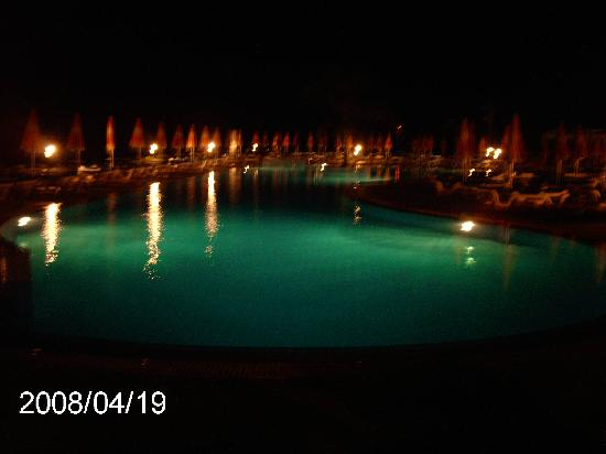 Asterias Beach Hotel: The pool at night.