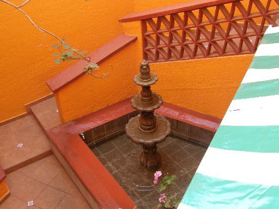 El Zopilote Mojado: Fountain in the house