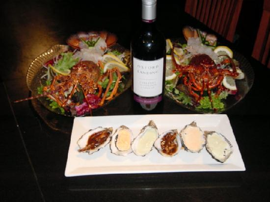 New Daniel's Steakhouse: Our Lobster Sashimi's, oyster to share and wine.