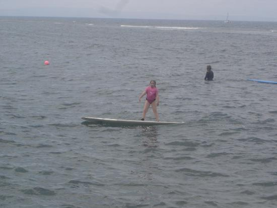 Opelu Surf School: our own surfer girl! First lesson and loving surfing!
