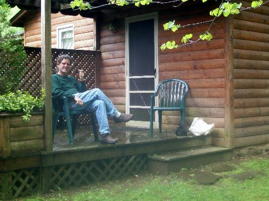 Brookside Cabins: My husband enjoying the deck