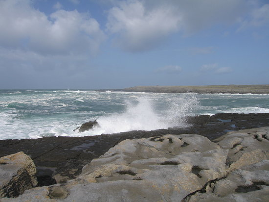 Doolin, Ireland: Waves crashing on the rocks at the Cliffs
