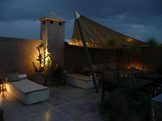 Riad Dar One: Rooftop terrace at dusk
