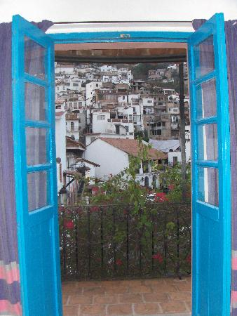 Santa Prisca : Looking out the turquoise doors to our balcony.