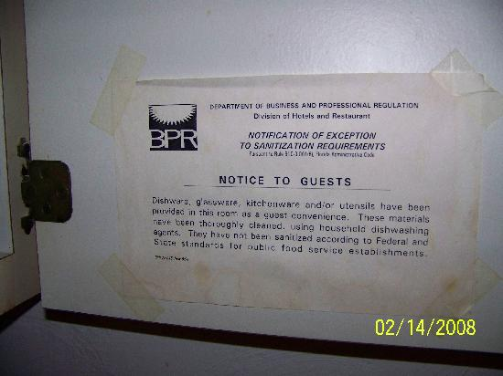 Beach Front Motel: Posting on the cabinet door, that states everything is sanitized - how sanitized does it look to