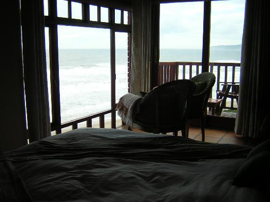Dolphin Dunes Guesthouse: The view from the bed to the Sea - the photo is a little dark but the room was lighter