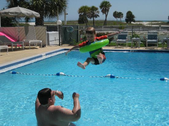 Arvilla Resort Motel Treasure Island: Older son taking flight in pool