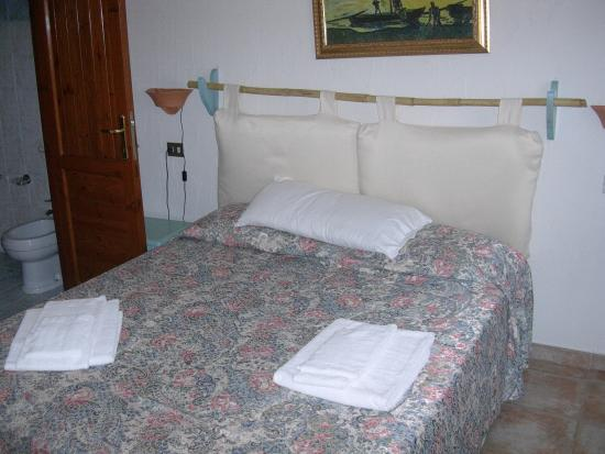 Le Corti di Marinella - View of bed and linen supplied