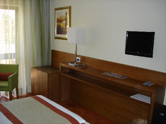 Hotel Marina Rio : Bedroom TV View.  Fridge is built under.